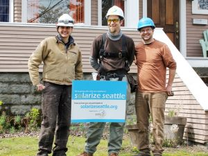 Solar installer crew with yard sign