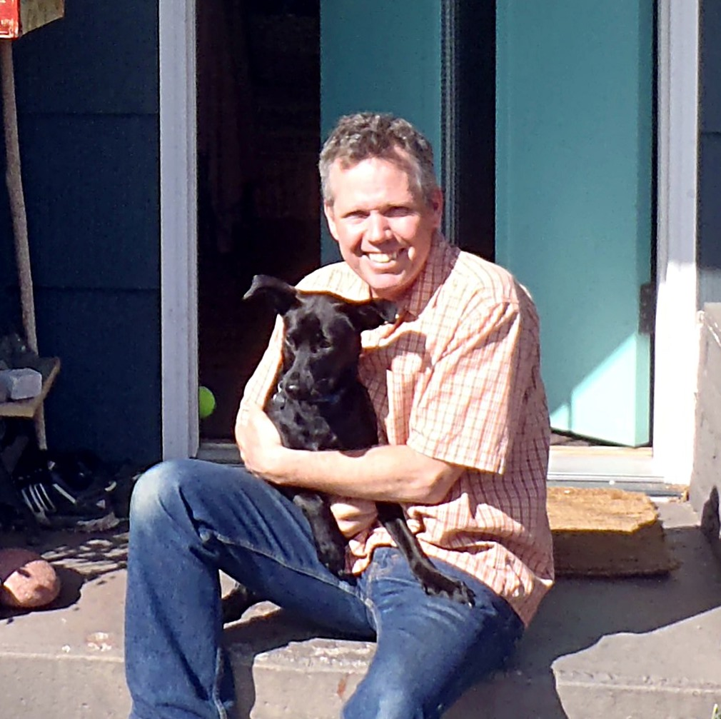 Willie Weir with dog on front stoop