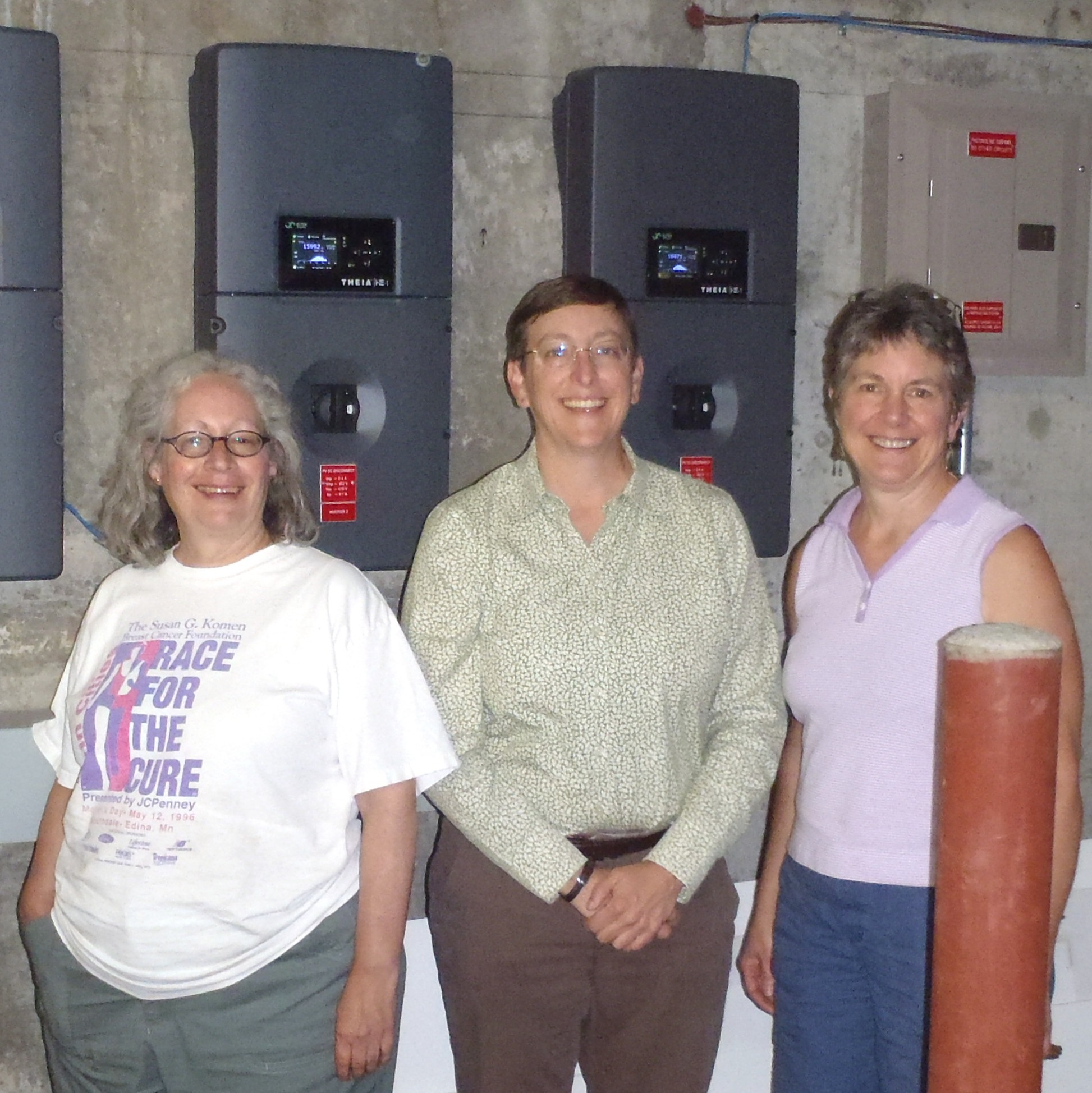 Members of Jackson place in front of solar panels
