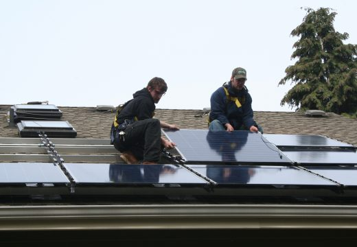 Workers on roof during installation for Solarize Northeast